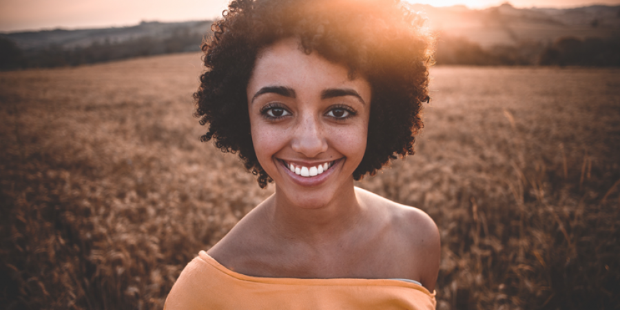 woman with a healthy and white smile, she knows about oral health